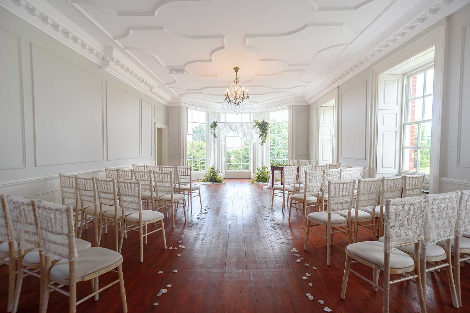 image of long gallery with chairs at gildredge manor